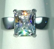 DR191 - SS EMERALD-CUT CZ SOLITAIRE RING (ONLY #7)
