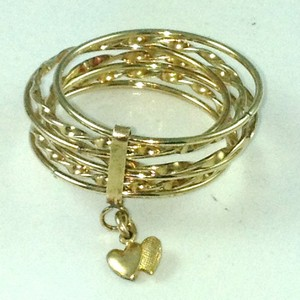 DR114 - Seven band ring set with heart charm