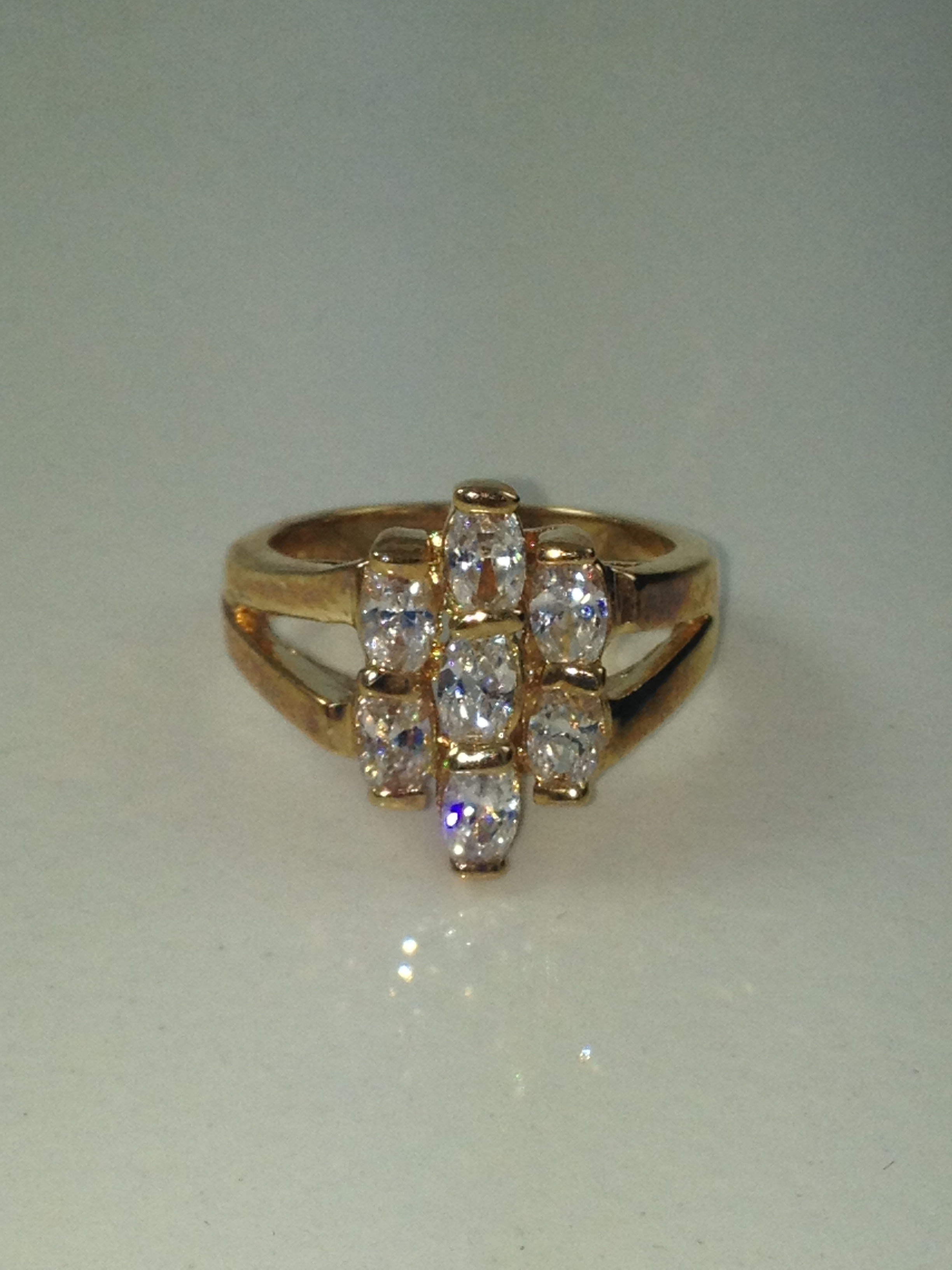 DR010 - SEVEN OVAL CUBIC ZIRCONIA CLUSTER RING
